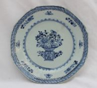 An 18th century Chinese porcelain plate of octagonal form painted to the centre with a vase of