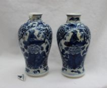 A garniture of three Chinese porcelain vases, the central vase with a flared rim and baluster body,