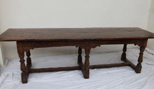 A 17th century style yew refectory table,