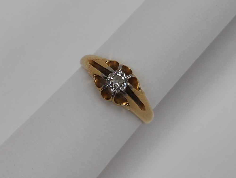 Lot 46 - An 18ct yellow gold signet ring set with an old round cut diamond, approximately 0.