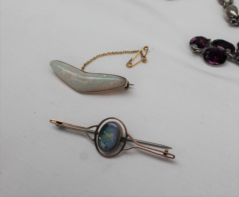 Lot 5 - A 9ct yellow gold opal bar brooch together with an irregular shape opal to a 9ct gold setting and a