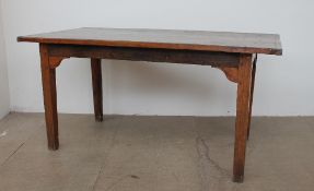 A 19th century elm refectory table, the planked cleated top on square tapering legs, 150.