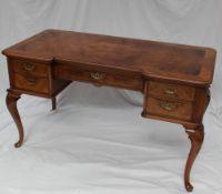 A 20th century walnut desk,