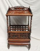 A Victorian rosewood Canterbury / whatnot, with a pierced three quarter gallery,