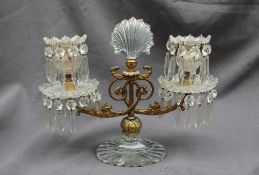 A 19th century gilt metal and cut glass twin branch candelabra, with a central glass fan,