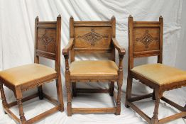 A set of six 17th century style oak dining chairs,