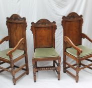 A set of eight 17th century style yew dining chairs,