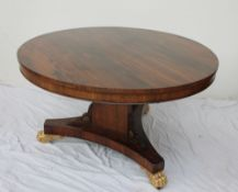 An early Victorian rosewood supper table,