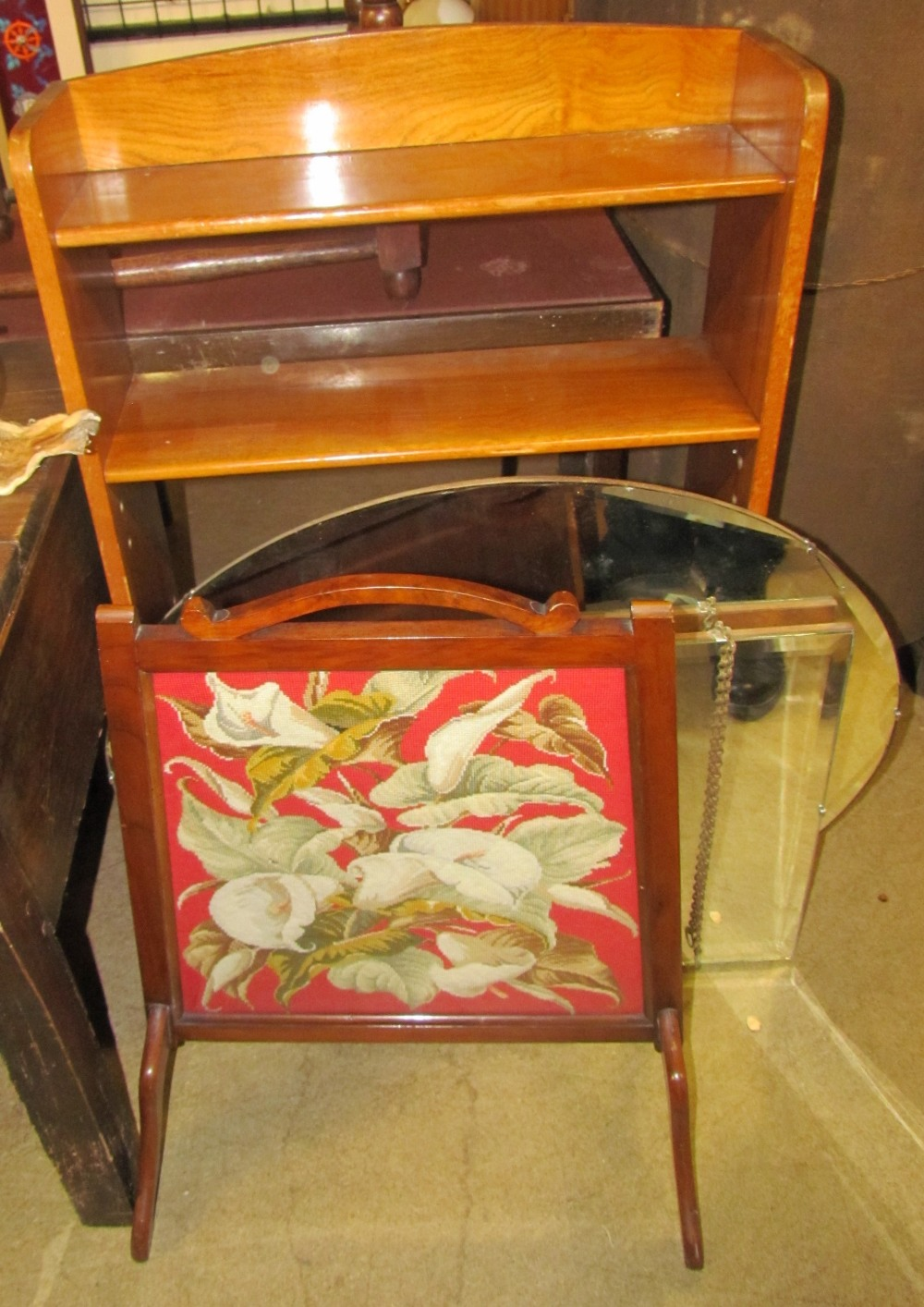 Lot 145 - A modern bookcase together with two wall mirrors and a fire screen