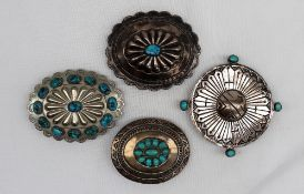An American Indian white metal and turquoise set belt buckle, marked sterling,