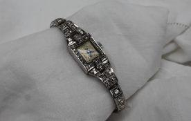An Art Deco diamond set cocktail watch,