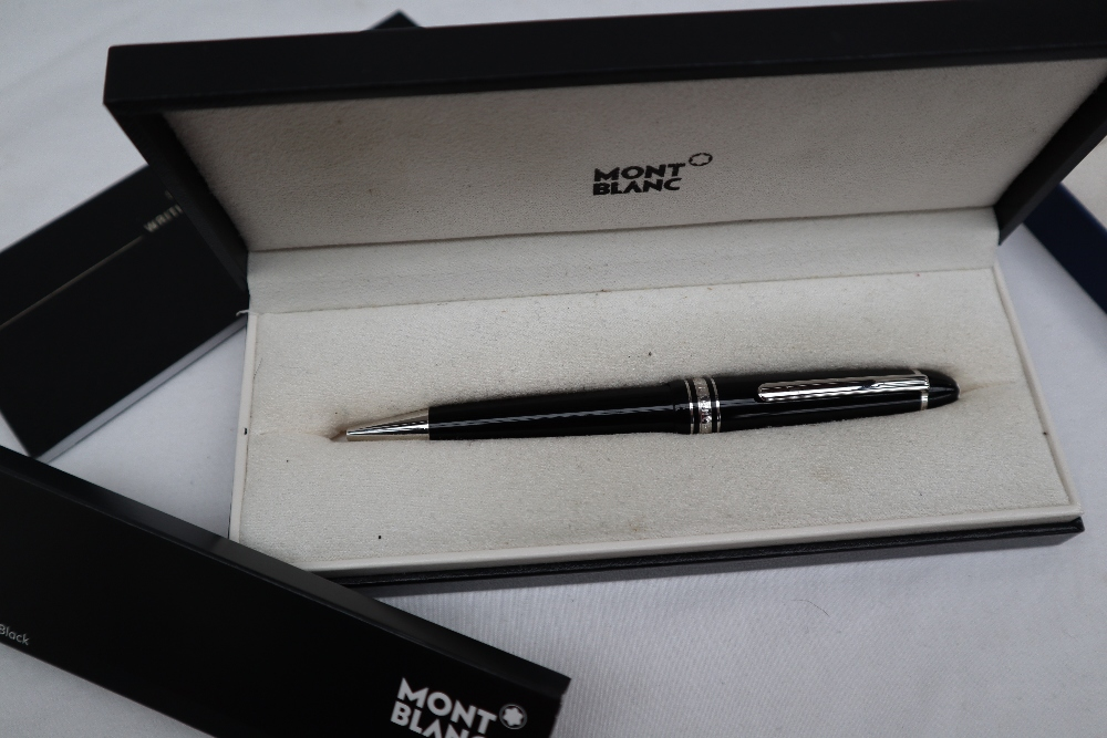 Lot 597 - A Montblanc Meisterstuck rollerball pen together with a Waterman propelling pencil,