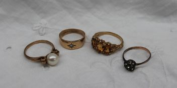 A pearl ring set to a scrolling 9ct gold shank together with a 9ct gold citrine set ring,