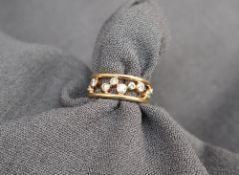 An 18ct yellow gold nine stone diamond ring, set with suspended round old cut diamonds,