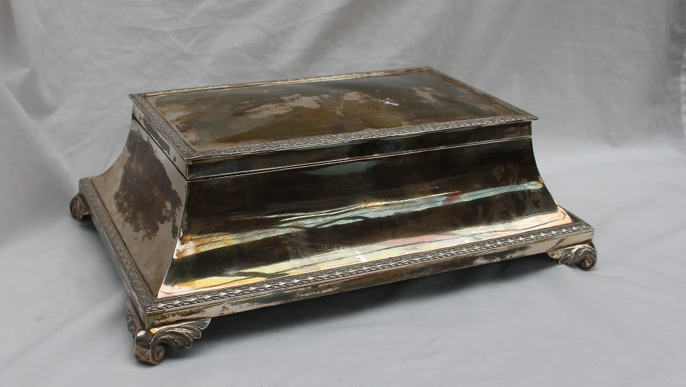 A large white metal table top cigarette box,