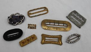 A collection of shoe buckles, various sizes,