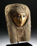 Lot 2 - Egyptian Late Dynastic Gilt Cartonnage Mummy Mask