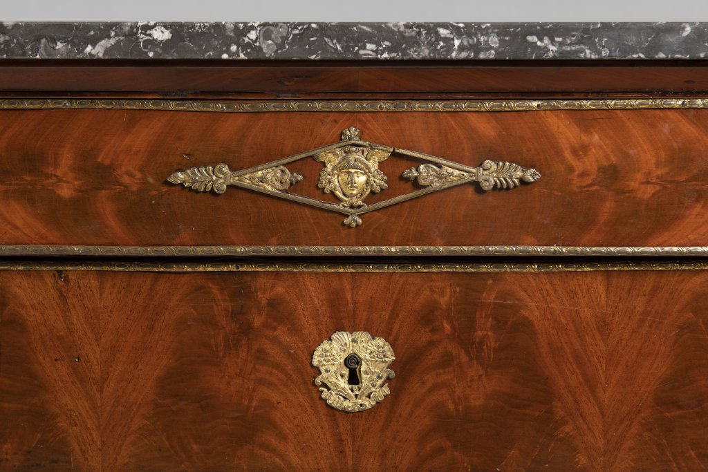Lot 48 - A FRENCH EMPIRE CHEST Ca. 1810 France Wood (walnut, flame mahogany), bronze, marble 93 x 130 x 56 cm