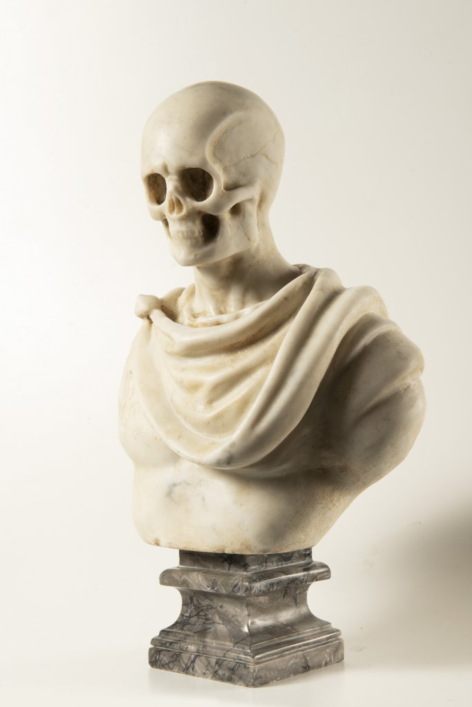 Lot 43 - A MEMENTO MORI 19th century Italy Marble 38 cm This rare white Carrara marble bust presents an