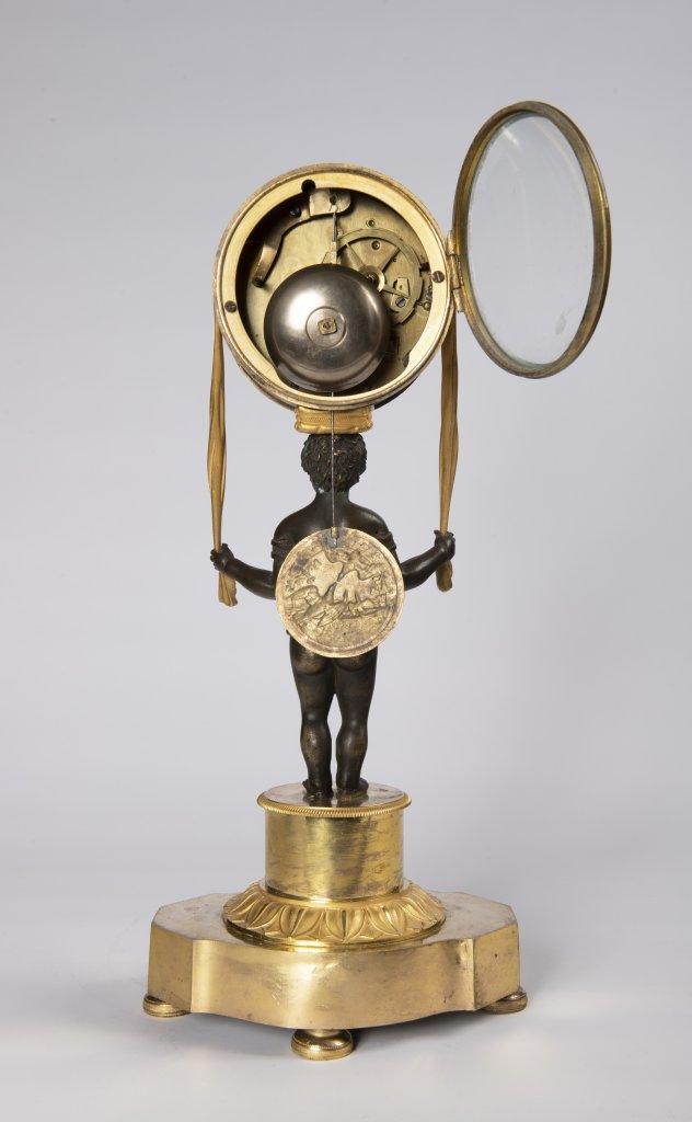 Lot 50 - AN EMPIRE TABLE CLOCK Ca. 1810 France Paøíž Gilt bronze, enamel 37 x 17 x 10 cm This elegant,
