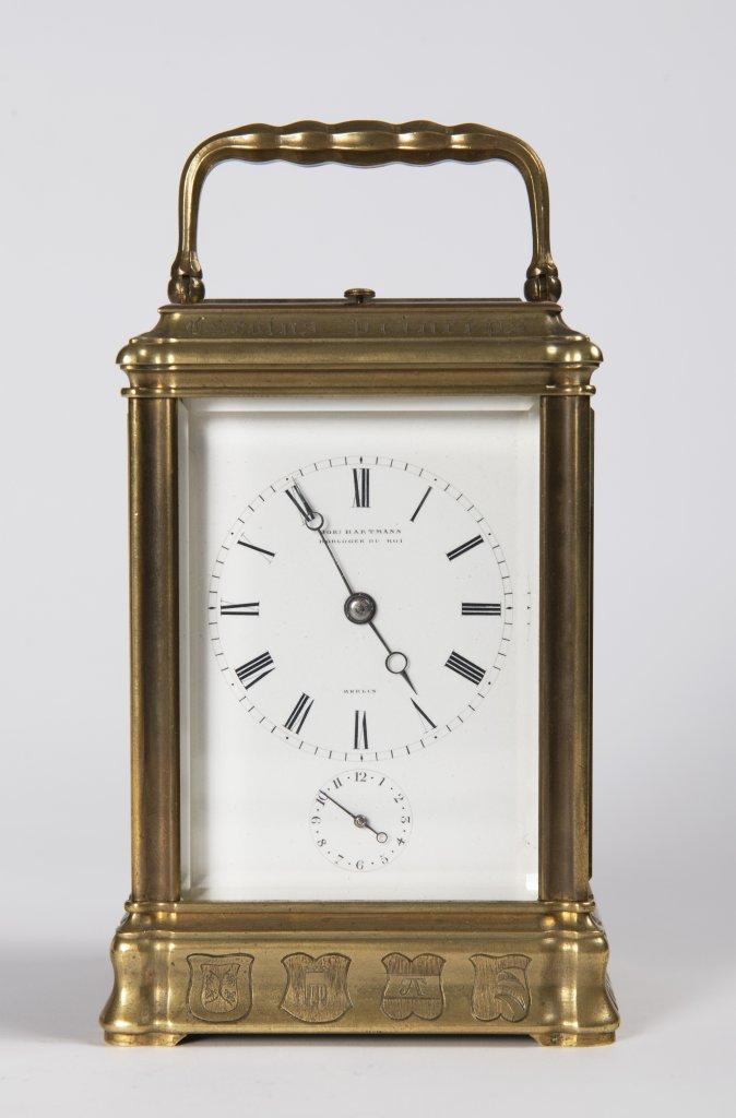 Lot 54 - JOHANNES HARTMANN: A TRAVEL ALARM CLOCK IN A CABINET 1861 Germany Berlín Gilt bronze 17,5 x 9 x 8,