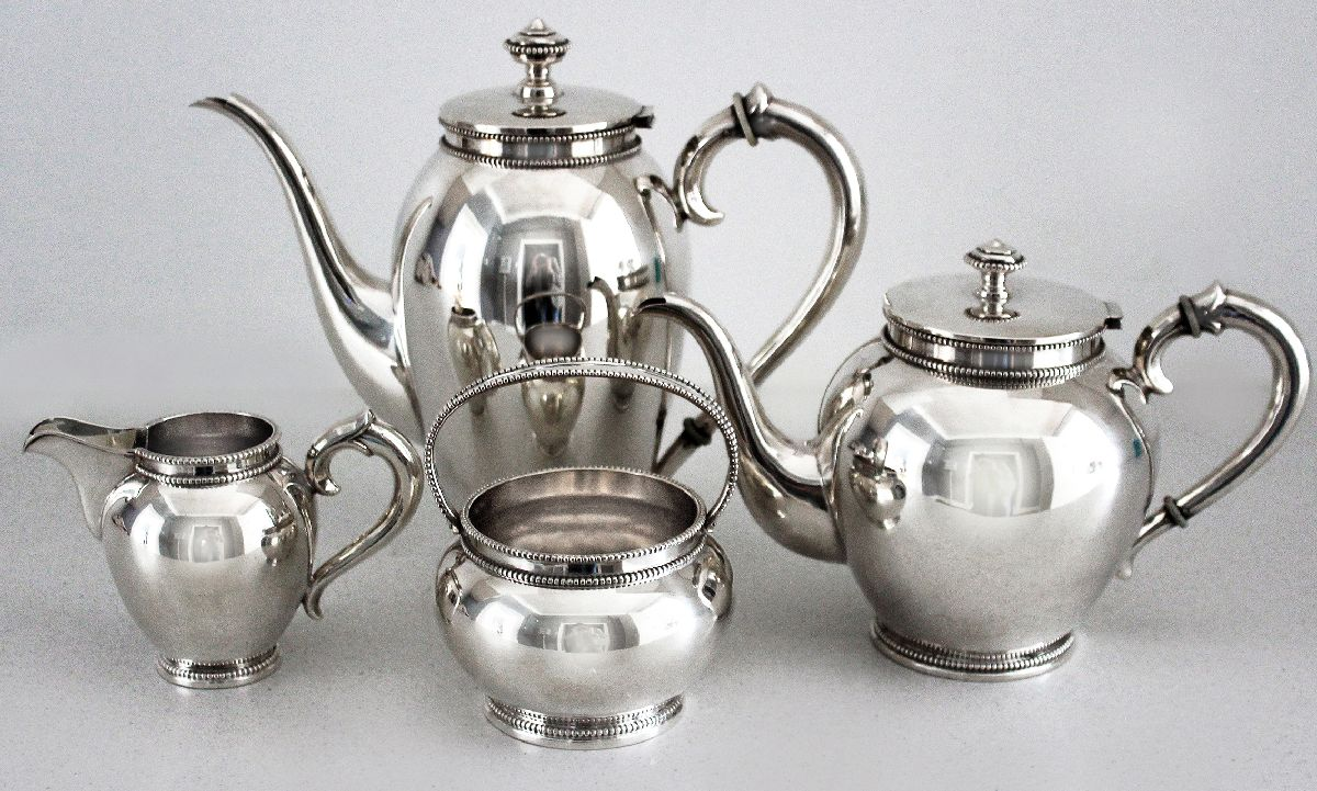 Lot 3 - A FOUR PIECE .835STD SILVER TEA AND COFFEE SERVICE, comprising: of a teapot, coffee pot, sugar