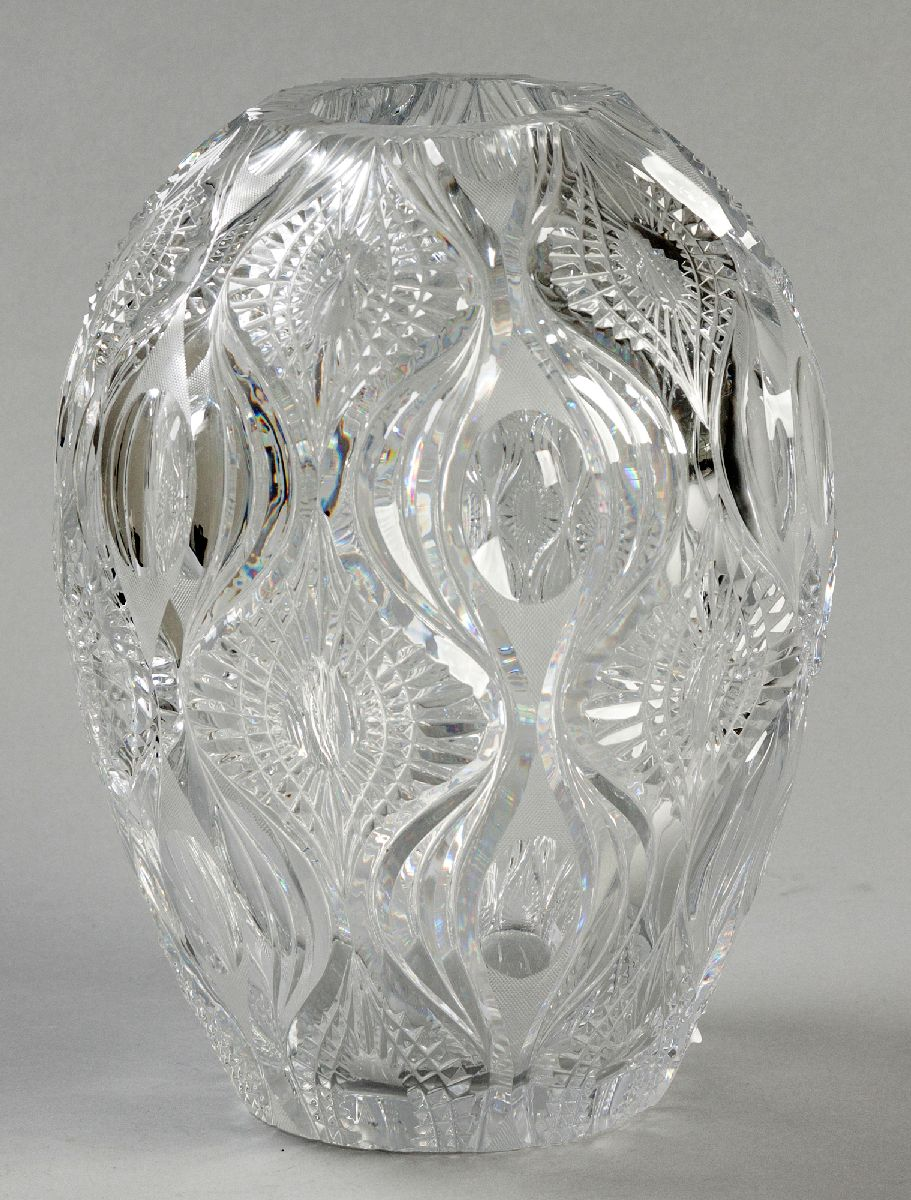 Lot 57 - A LARGE CZECHOSLOVAKIAN CUTGLASS VASE, of bulbous-form, decorated with organic shapes and forms,