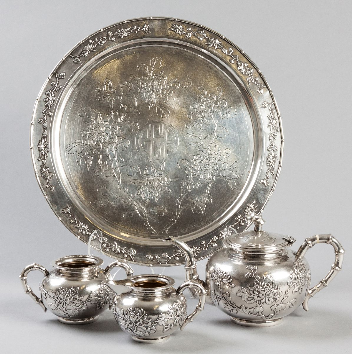 Lot 30 - A CHINESE THREE PIECE SILVER TEA SET AND TRAY, STAMPED SHANGHAI, LUEN-WO, CANTON, comprising: of a