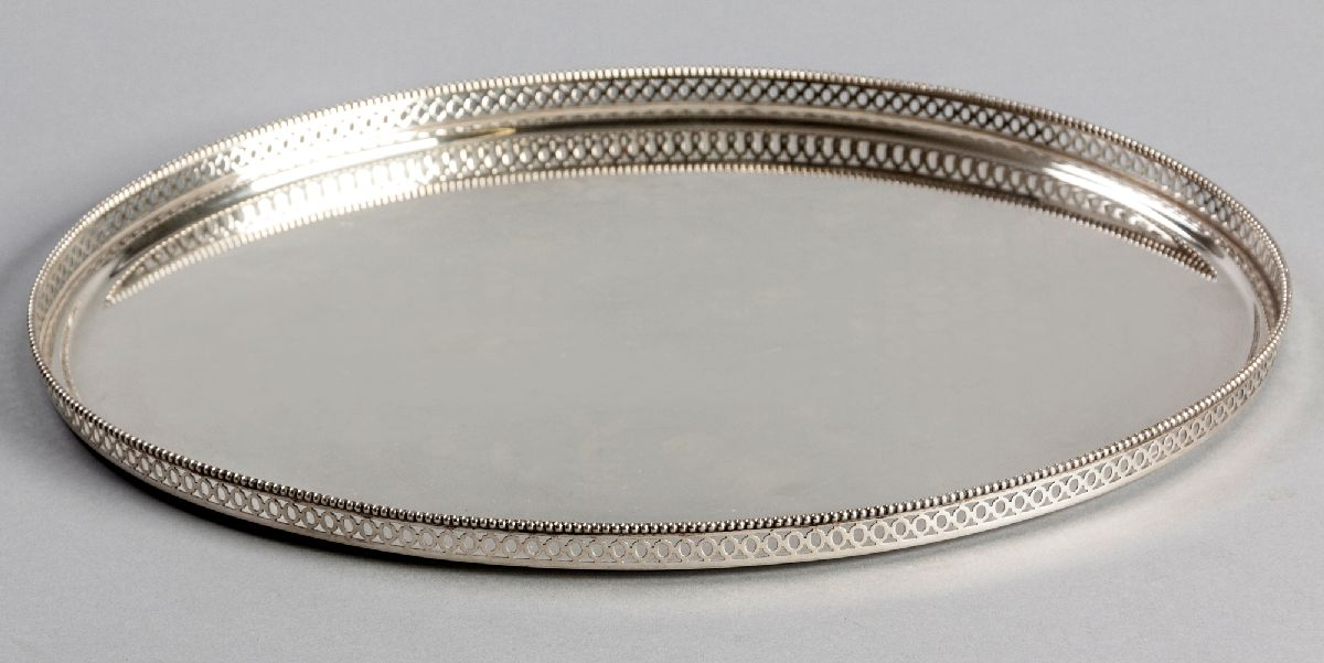 Lot 4 - A .835STD SILVER TRAY, of oval-form, beaded rim, the border with cut-out decoration, plain well,