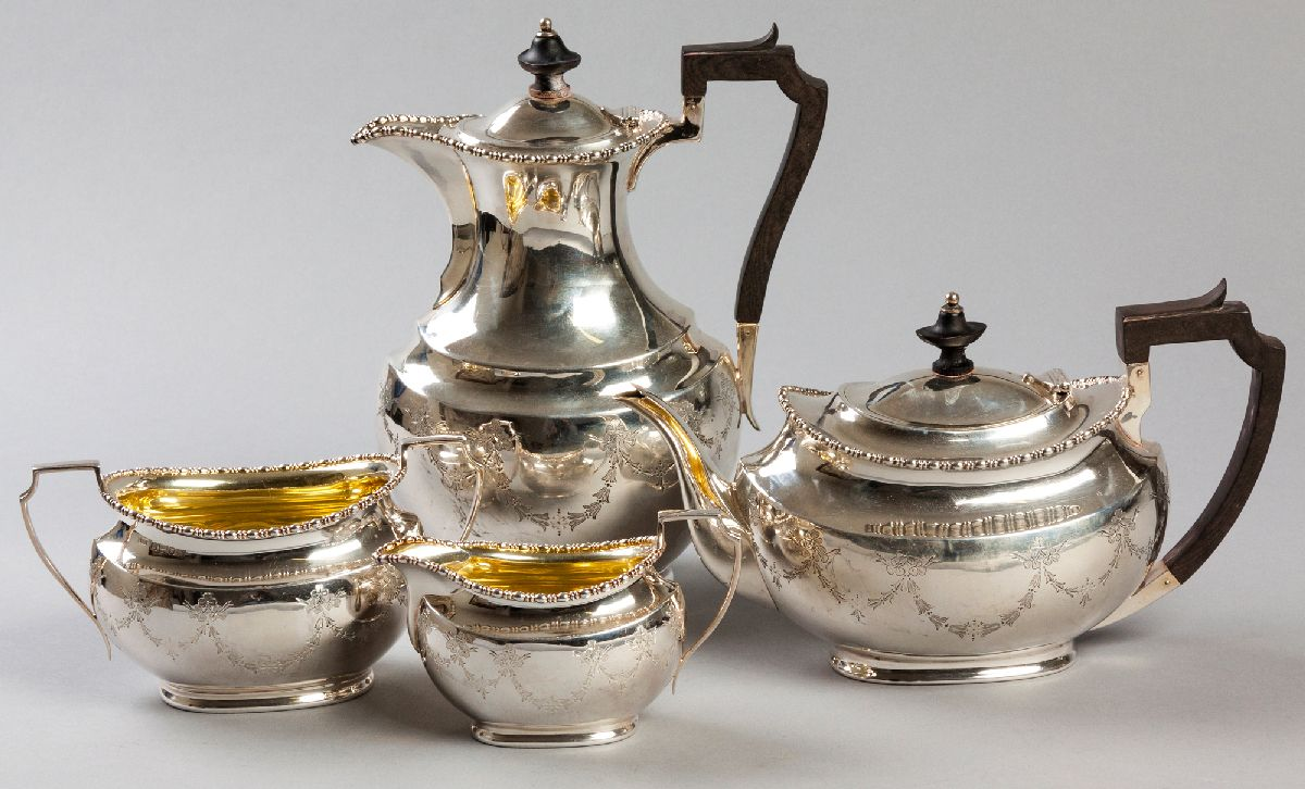Lot 24 - AN EDWARDIAN FOUR PIECE SILVER TEA AND COFFEE SERVICE, SHEFFIELD 1910, H.A., comprising: of a