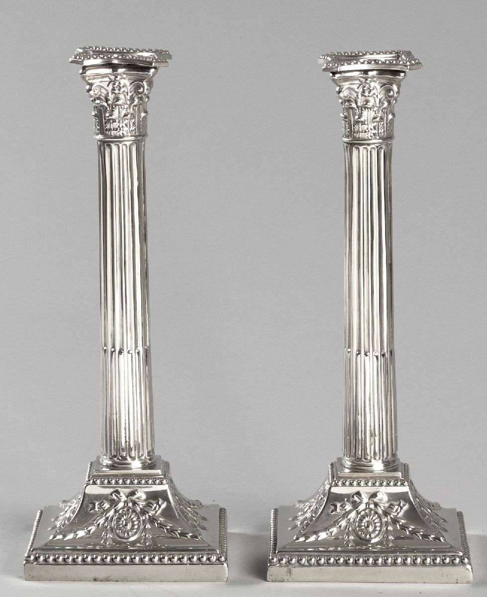 Lot 35 - A PAIR OF SILVERPLATE CORINTHIAN COLUMN CANDLESTICKS, with beaded removable wax pans, reeded stem,