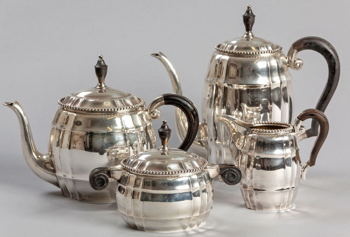 Lot 2 - A FOUR PIECE .800STD SILVER TEA AND COFFEE SERVICE, comprising: of a teapot, coffee pot, creamer and