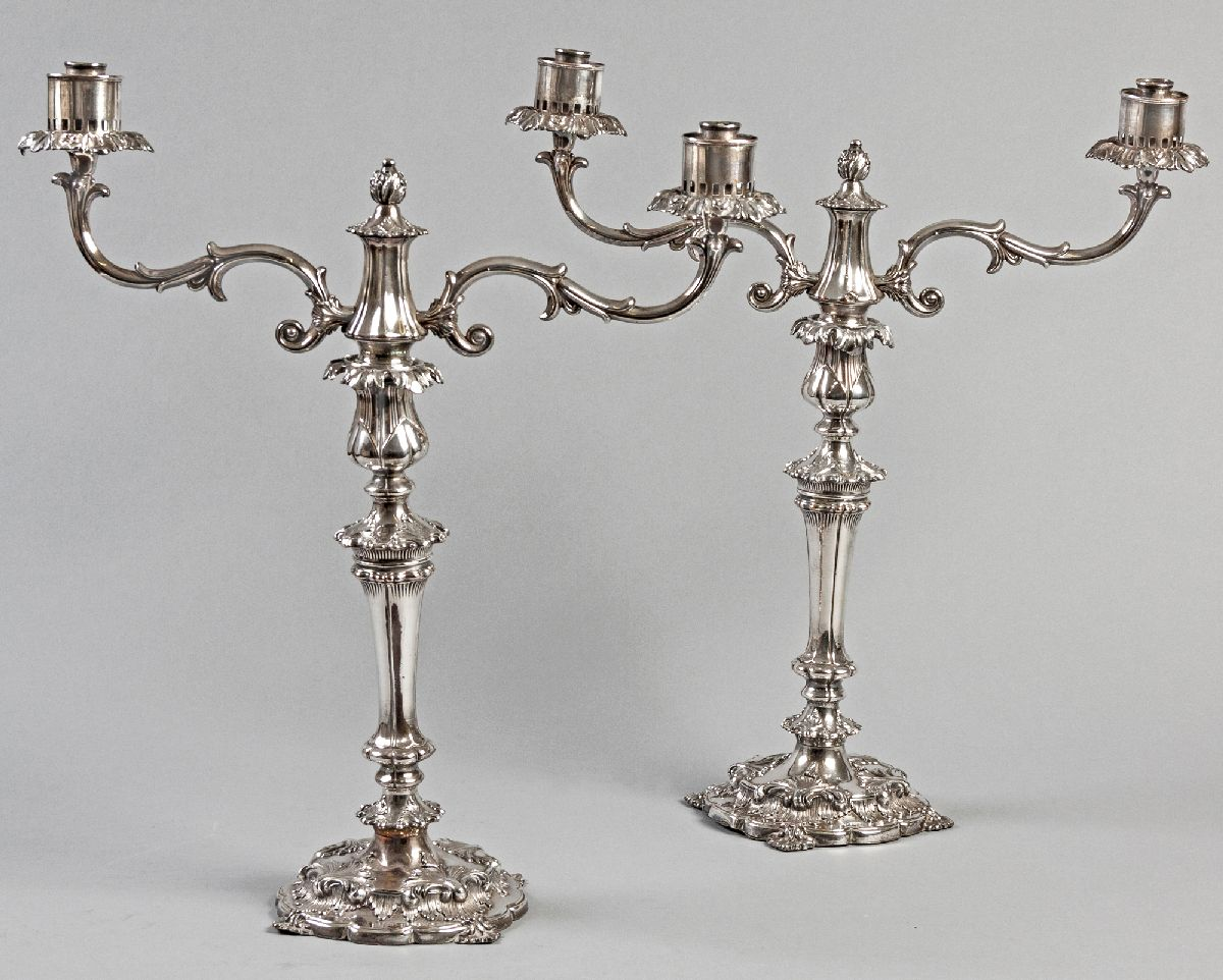 Lot 46 - A PAIR OF SILVERPLATE CANDELABRA, the removable twin branches with floral-form finials, the stem