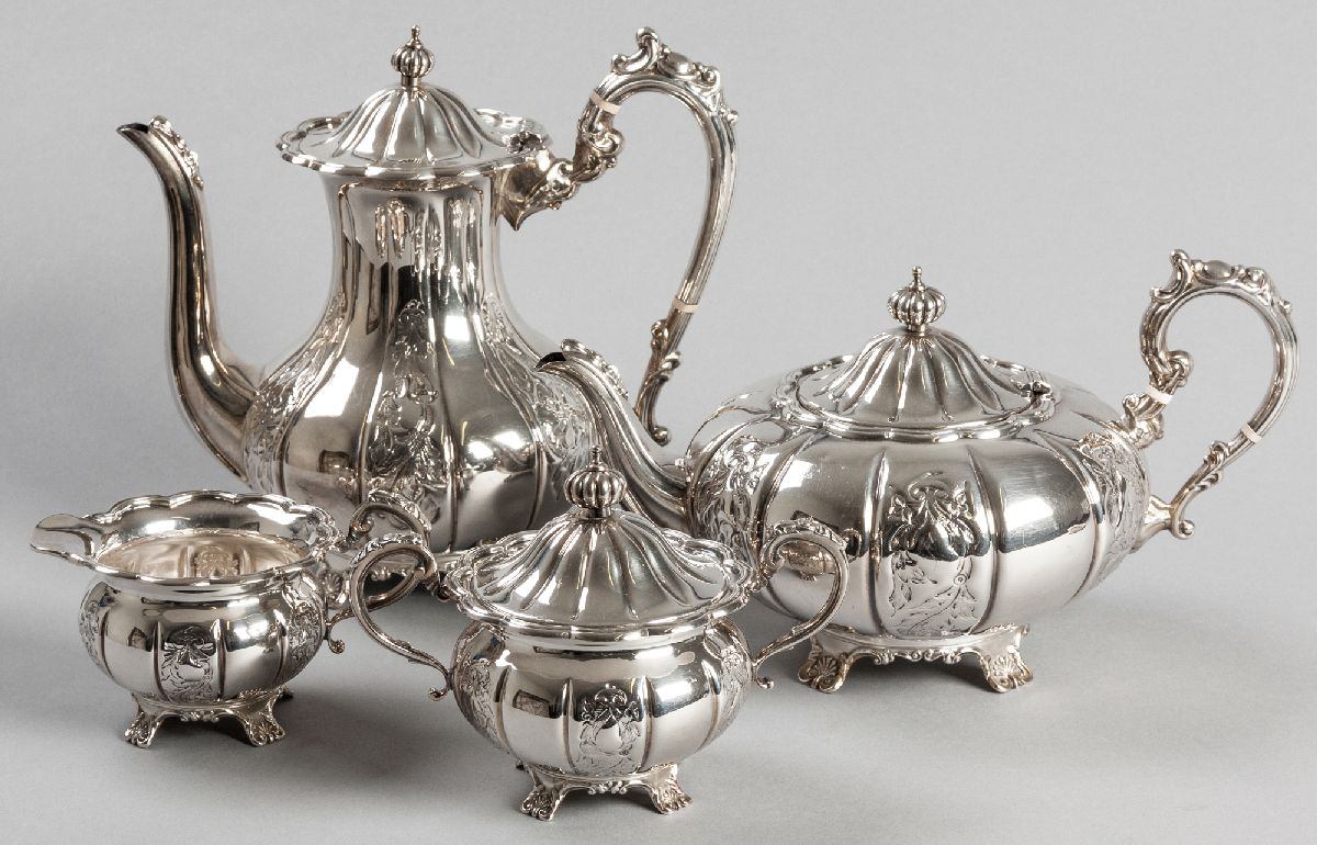 Lot 8 - A 20TH CENTURY FOUR PIECE TEA AND COFFEE SERVICE, BIRMINGHAM 1972, F.H., comprising: of a teapot,