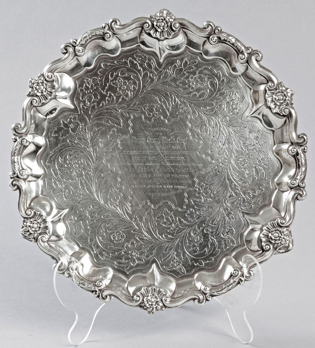 Lot 25 - A GEORGE VI SILVER SALVER, LONDON 1932, J.J.C., with applied serpentine border, decorated with