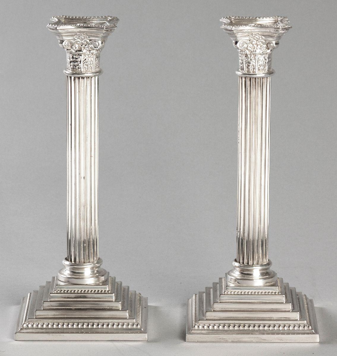 Lot 36 - A PAIR OF SILVERPLATE CORINTHIAN COLUMN CANDLESTICKS, BY GODDINGER, beaded, rimmed wax pans, of
