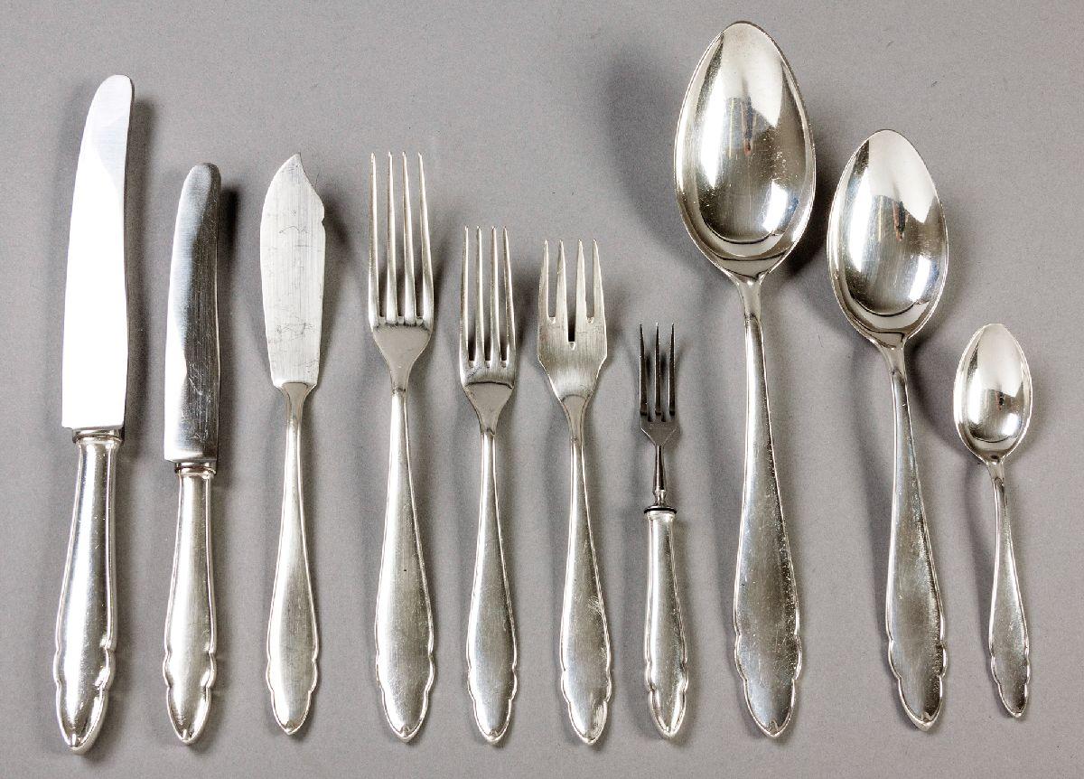 Lot 13 - AN ASSEMBLED SET .800STD SILVER FLATWARE, comprising: six dinner knives, six dinner forks, five