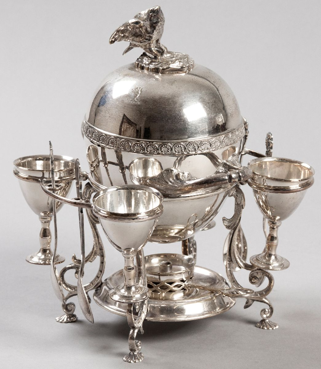 Lot 38 - A SILVERPLATE EGG CODDLER, the removable top with eagle-form finial, shell embossed border with twin