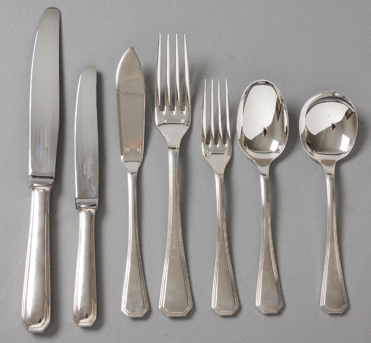 Lot 42 - AN EIGHT PLACE SILVERPLATE CHRISTOFLE CUTLERY SET, comprising: of 8 dinner knives, 8 dinner forks, 8