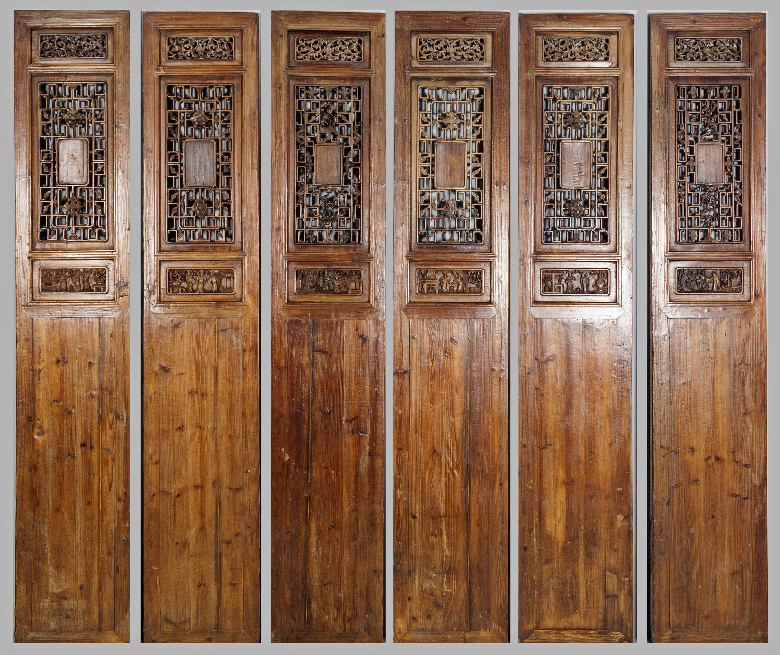 Lot 394 - A SET OF SIX ORIENTAL HARDWOOD SCREEN PANELS, the upper-section with pierced and fretted panels,