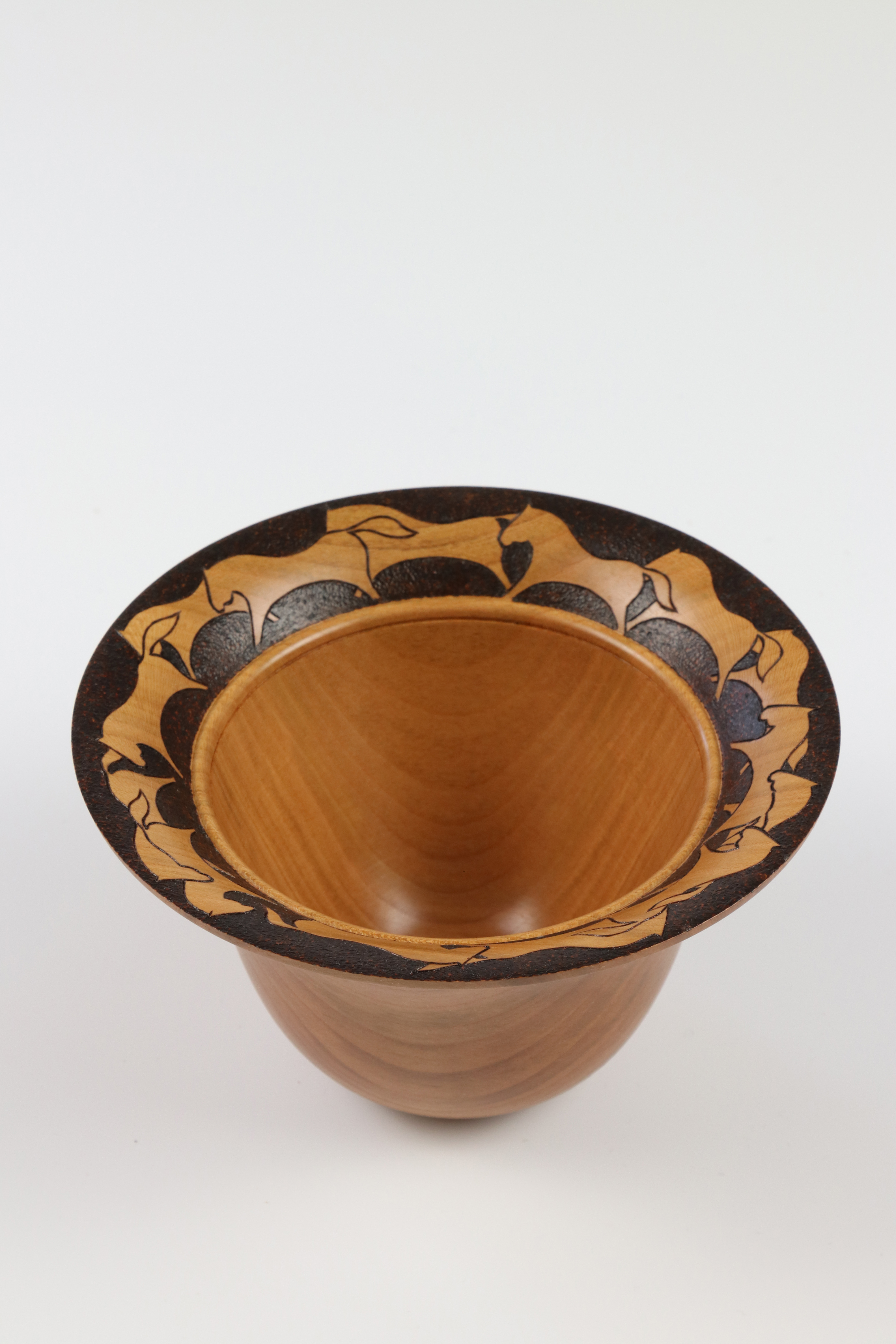 Lot 85 - Molly Winton (USA) canarywood decorated bowl 8x14cm. Signed