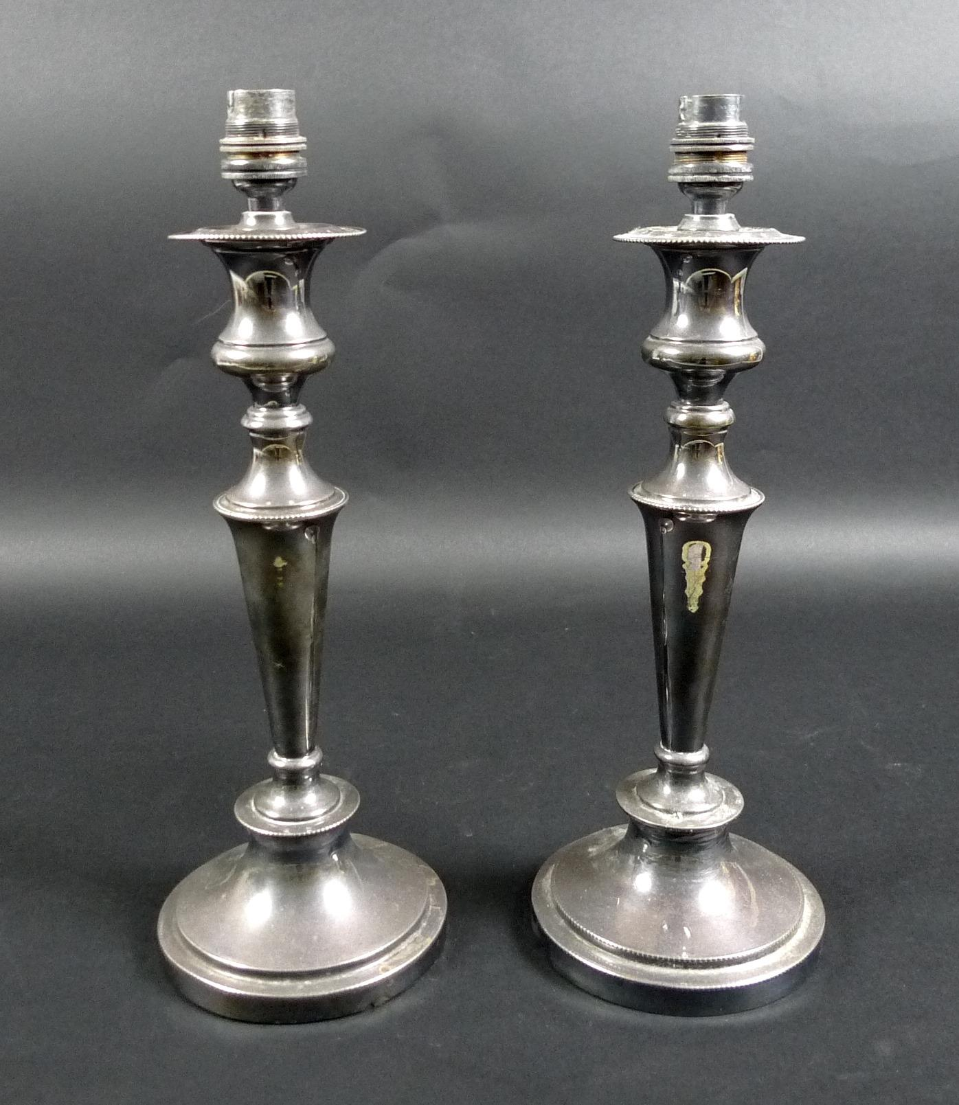 Lot 3 - A pair of silver plated table lamps, converted from candlesticks with removable drip trays, of