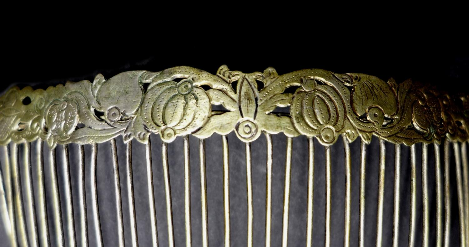 Lot 119 - A group of five 19th century Chinese white metal hair clips, comprising a quartet stamped with a