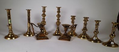 Metalware, comprising; five pairs of 19th century brass candlesticks, the tallest 25cm high, (10).