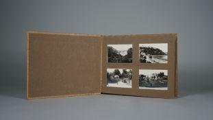 PHOTOGRAPH ALBUM: an early 20th century cloth bound album, 16pp, 64 b/w.