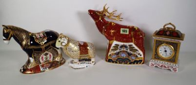 Four Royal Crown Derby Imari paperweights, including a stag, a mantel clock, a horse and a ram, (4).