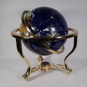 A 20th century specimen stone table globe, on a brass metal base, approx. 48cm wide x 45cm high.