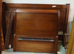 A 20th century hardwood framed double bed, 158cm wide x 116cm high,