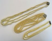 A three row necklace of graduated cultured pearls, on a Sterling silver and marcasite clasp,