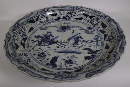 A very large Chinese blue and white Ming style dish, modern, painted with two figures on horseback,